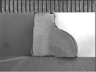 Macrografía de unión en ángulo de chapa de 5mm, con falta de penetración en la chapa inferior